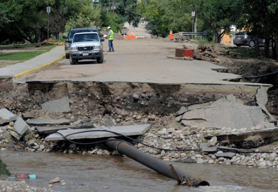A road destroyed by flooding. (Photo: LA Times)